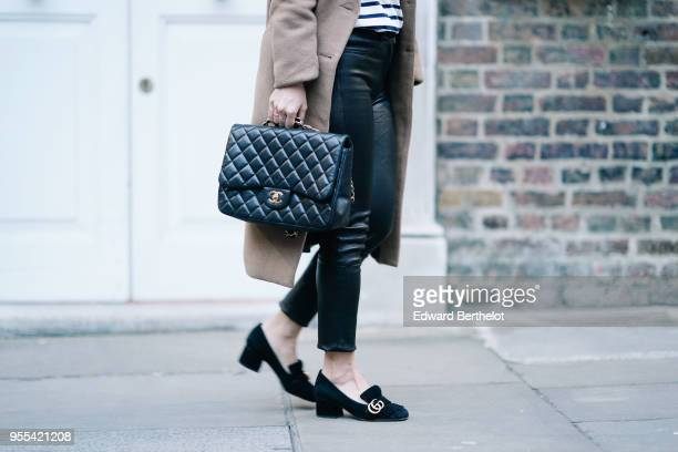 Chanel Jumbo bag Gucci shoes black leather pants during London Fashion Week February 2018 on February 18 2018 in London England