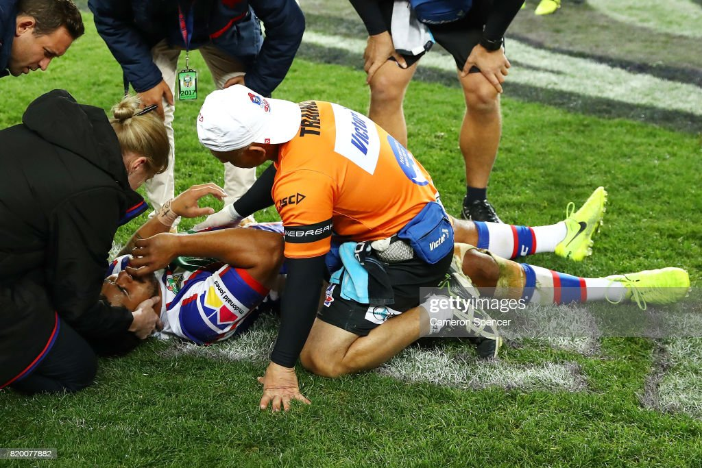 Chanel Mata'utia of the Knights receives medical attention after being knocked out during the round 20 NRL match between the Sydney Roosters and the Newcastle Knights at Allianz Stadium on July 21, 2017 in Sydney, Australia.