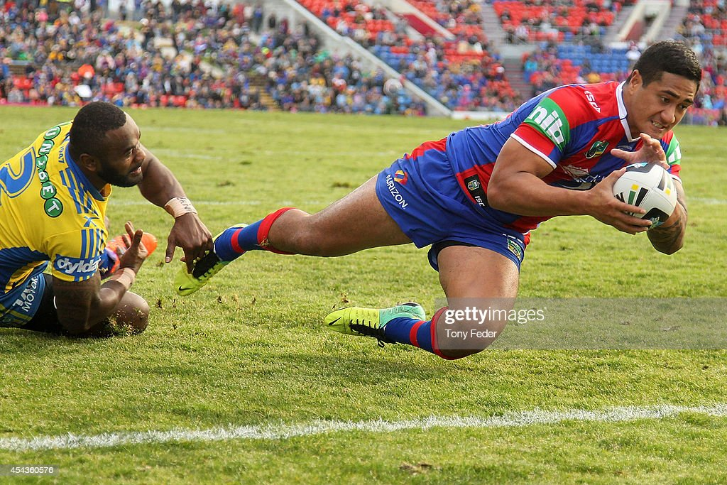 Chanel Mata'Utia of the Knights scores a try during the round 25 NRL match between the Newcastle Knights and the Parramatta Eels at Hunter Stadium on August 30, 2014 in Newcastle, Australia.