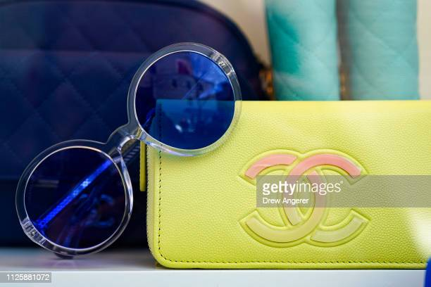 Chanel merchandise sits in a storefront window at a Chanel store in the SoHo neighborhood of Manhattan, February 19, 2019 in New York City. Karl...