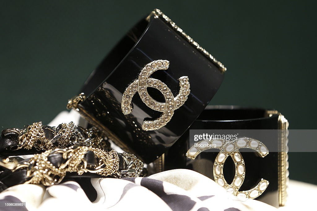 Chanel SA branded goods are displayed in the window of the store in the Ginza district of Tokyo, Japan, on Sunday, Jan. 20, 2013. Japan's consumer prices excluding fresh food, a benchmark monitored by the central bank, haven't advanced 2 percent for any year since 1997, when a national sales tax was increased. Photographer: Kiyoshi Ota/Bloomberg via Getty Images