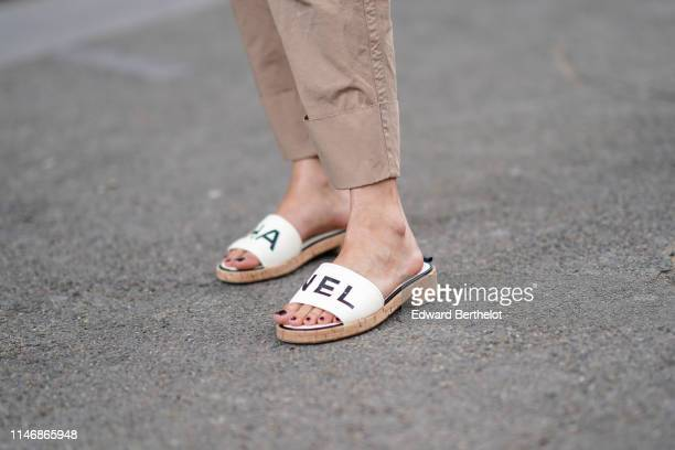 Chanel sandals are seen, outside the Chanel Cruise Collection 2020 At Grand Palais on May 03, 2019 in Paris, France.
