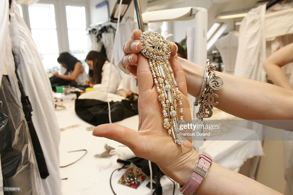 A Chanel seamstress holds an accessory to put the final touches to the Chanel Haute Couture Fall-Winter 2006/07 Fashion collection during Paris Fashion Week in the Chanel workshop above rue Cambon on July 5, 2006 in Paris, France.