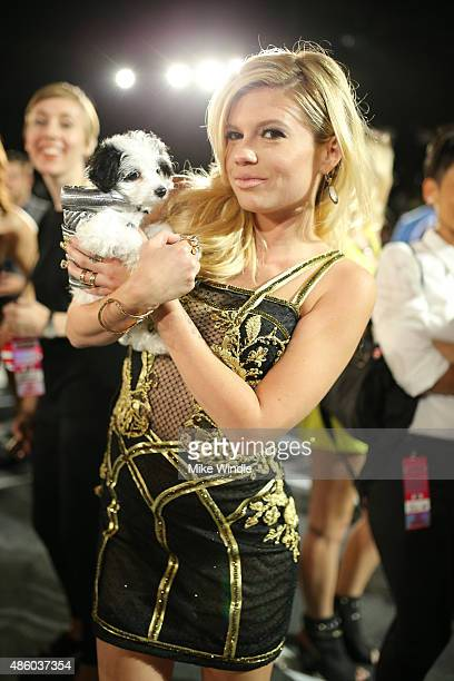 Chanel West Coast poses with adoptable puppies from The Shelter Pet Project during the 2015 MTV Video Music Awards at Microsoft Theater on August 30...