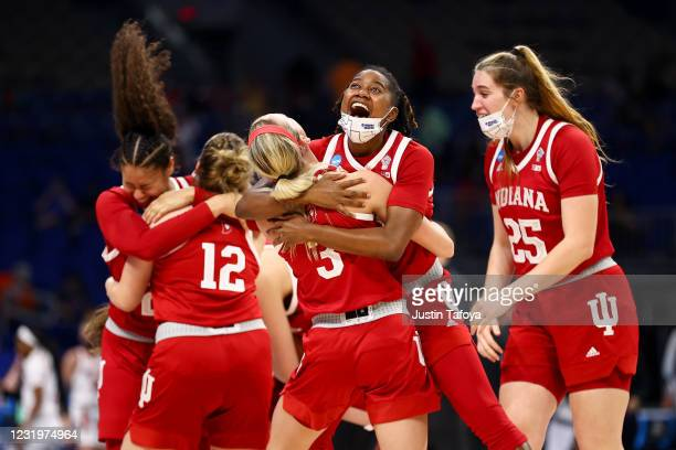 Chanel Wilson and Grace Waggoner of the Indiana Hoosiers celebrates after defeating the NC State Wolfpack in the Sweet 16 at Alamodome on March 27,...