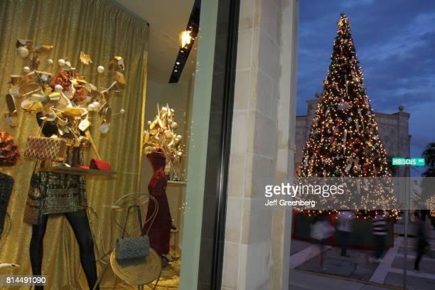 Chanel window display and a Christmas tree on Worth Avenue