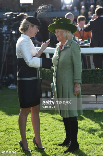 Chanelle McCoy speaks with Camilla Duchess of Cornwall as they attend the second day of The Festival Ladies Day at Cheltenham Racecourse on March 15...