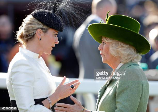 Chanelle McCoy talks with Camilla Duchess of Cornwall as they attend day 2 'Ladies Day' of the Cheltenham Festival at Cheltenham Racecourse on March...