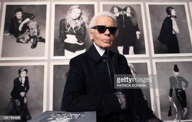 Chanel's creative director Karl Lagerfeld poses on November 8 2012 before the opening of his photo exhibition entitled Little Black Jacket at the...