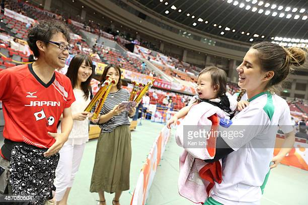 Chanez Ayadi of Algeria holds a baby after the match between Russia and Algeria during the FIVB Women's Volleyball World Cup Japan 2015 at Nippon...