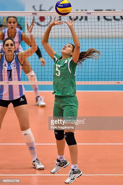 Chanez Ayadi of Algeria tosses the ball in the match against Argentina during the FIVB Women's Volleyball World Cup Japan 2015 at Momotaro Arena on...