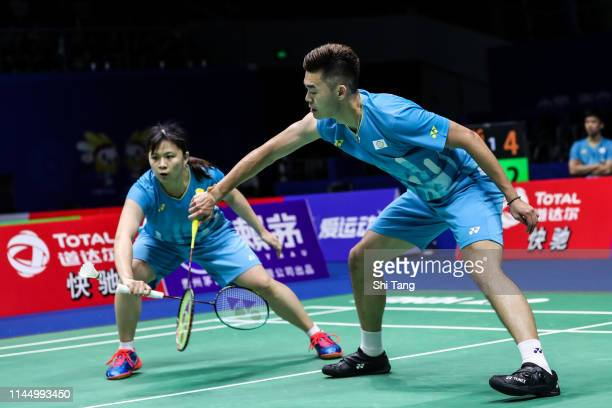Chang Ching Hui and Wang ChiLin of Chinese Taipei compete in the Mixed Doubles match against Tang Chun Man and Tse Ying Suet of Hong Kong during day...
