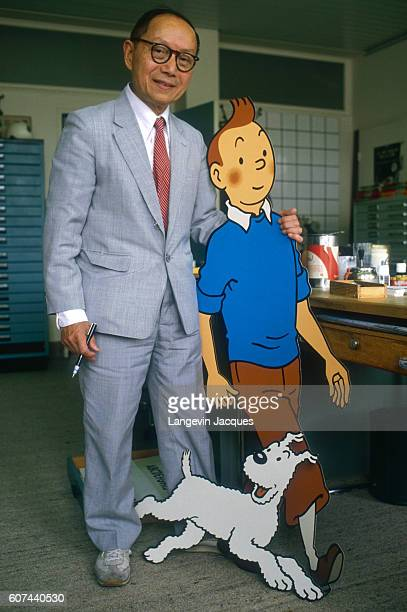 Chang ChongChen poses next to a cutout of the character Tintin and his dog Snowy from the Adventures of Tintin comic books by Herge Mr Chang is the...