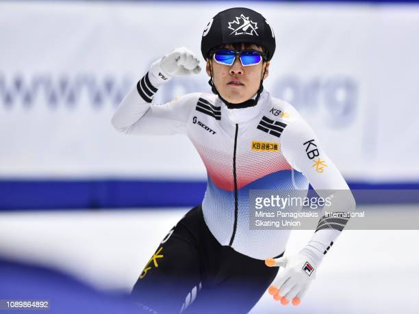 Chang Hyun Woo of Korea celebrates after finishing first in the men's 1500 meter final during the ISU World Junior Short Track Championships at...