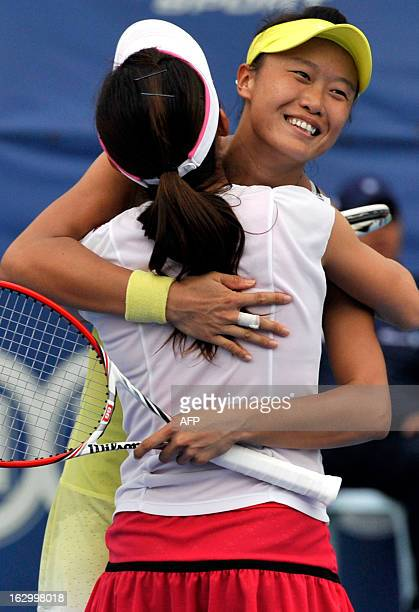 Chang Kai-Chen of Taiwan and Shuko Aoyama of Japan celebrate their win against Janette Husarova of Slovakia and Shuai Zhang of China during their...