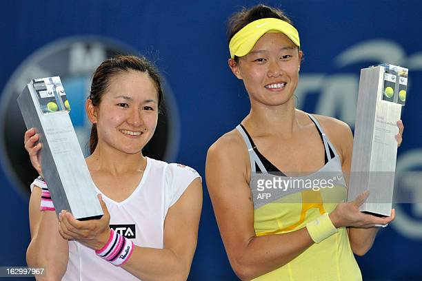 Chang Kai-Chen of Taiwan and Shuko Aoyama of Japan pose with their trophy after defeating Janette Husarova of Slovakia and Shuai Zhang of China...