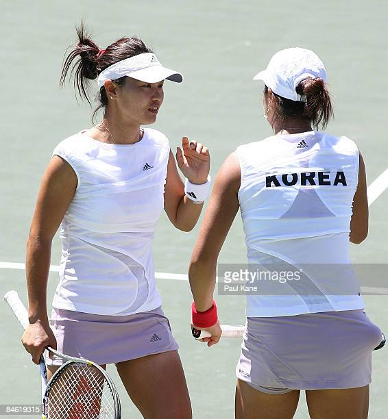 Chang Kyung Mi and Lee JinA of Korea talk tactics during the doubles match in the first round Fed Cup match between Australia and Korea at The State...