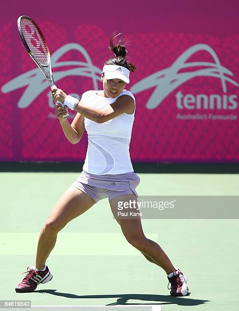 Chang Kyung Mi of Korea plays a return shot during the doubles match in the first round Fed Cup match between Australia and Korea at The State Tennis...