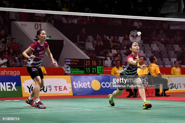 Chang Ye Na and Jung Kyung Eun of Korea compete against Misaki Matsutomo and Ayaka Takahashi of Japan during the Women's Doubles Quarter Final match...