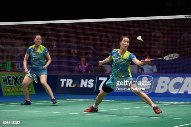 Chang Ye Na and Lee So Hee of Korea compete against Greysia Polii and Apriyani Rahayu of Indonesia during Womens Double Round 2 match of the BCA...