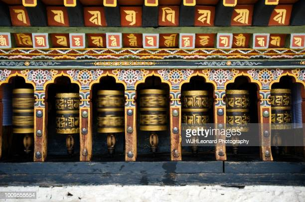 changangkha lhakhang prayer wheels spinning - bhutan stock pictures, royalty-free photos & images