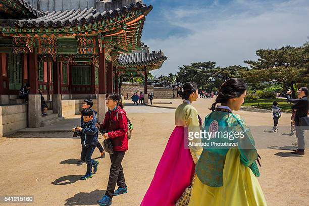 Changdeokgung Palace Complex (Unesco World Heritage), women with typical dresses near the entrance pavilion of the Huijeongdang Hall