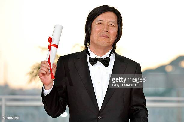 ChangDong Lee with his award of Best Screenplay at the photo call for 'The Palme d'Or Award Ceremony during the 63rd Cannes International Film...
