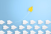 Change concepts with yellow paper airplane leading among white
