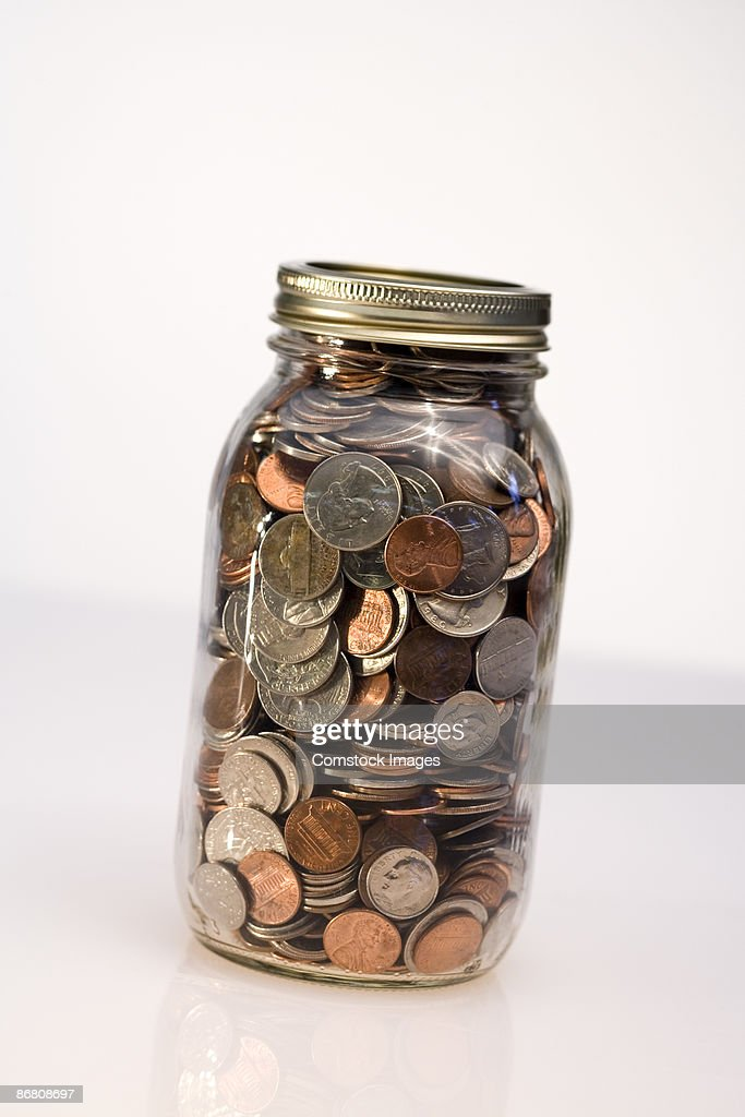 change in a jar ストックフォト getty images
