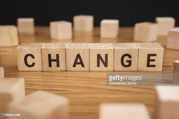 change word on wooden block - symbol stock pictures, royalty-free photos & images