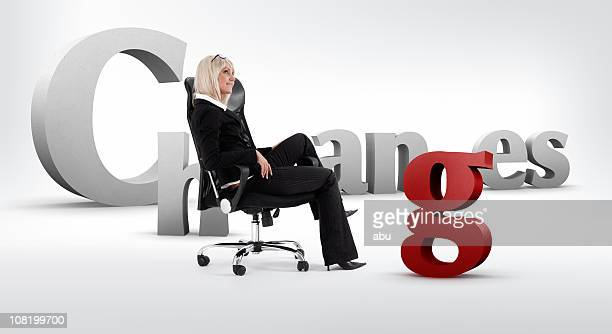 Changes- Background and Businesswoman Sitting in Office Chair