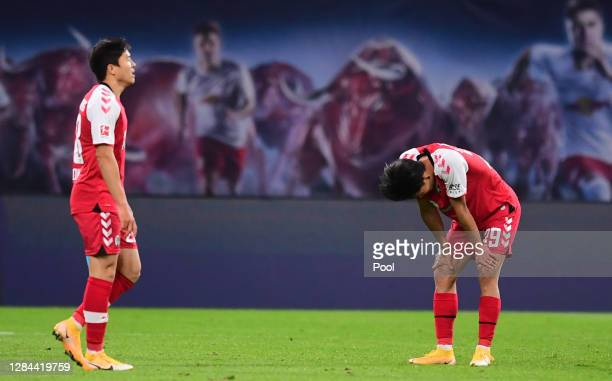 Chang-hoon Kwon and Woo-Yeong Jeong of Freiburg react after the Bundesliga match between 1. FSV Mainz 05 and FC Schalke 04 at Opel Arena on November...