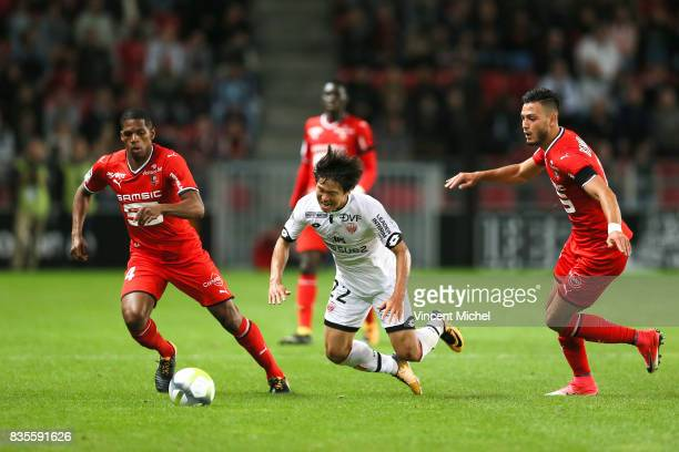 Changhoon Kwon of Dijon and Ludovic Baal and Rami Bensebaini of Rennes during the Ligue 1 match between Stade Rennais and Dijon FCO at Roazhon Park...