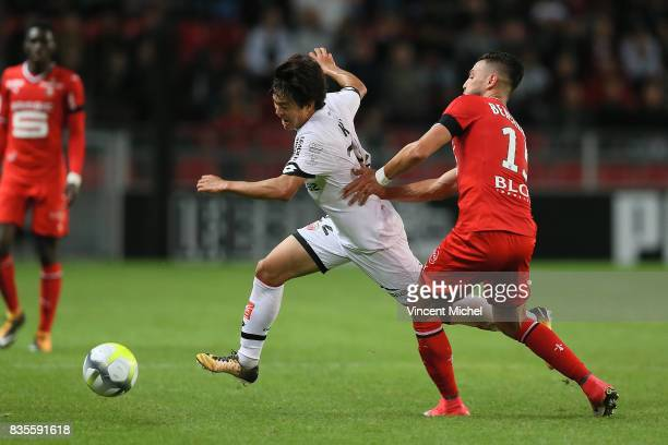 Changhoon Kwon of Dijon and Rami Bensebaini of Rennes during the Ligue 1 match between Stade Rennais and Dijon FCO at Roazhon Park on August 19 2017...