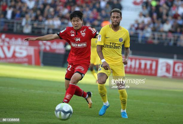 Changhoon Kwon of Dijon Neymar Jr of PSG during the French Ligue 1 match between Dijon FCO and Paris Saint Germain at Stade Gaston Gerard on October...