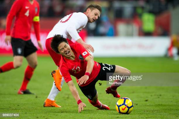 Chang-hoon Kwon of Korea fouled by Lukasz Piszczek of Poland during the international friendly match between Poland and South Korea at Silesian...