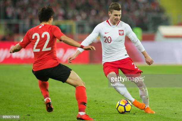 Chang-hoon Kwon vies Lukasz Piszczek of Poland during the international friendly soccer match between Poland and South Korea national football teams,...