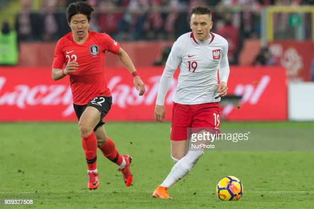 Chang-hoon Kwon vies Piotr Zielinski of Poland during the international friendly soccer match between Poland and South Korea national football teams,...