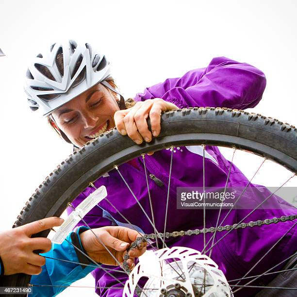 Changing a bike tire.