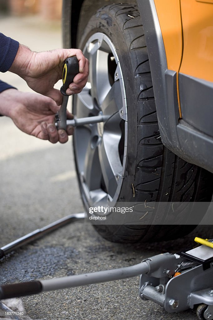 Changing a wheel : Stock Photo