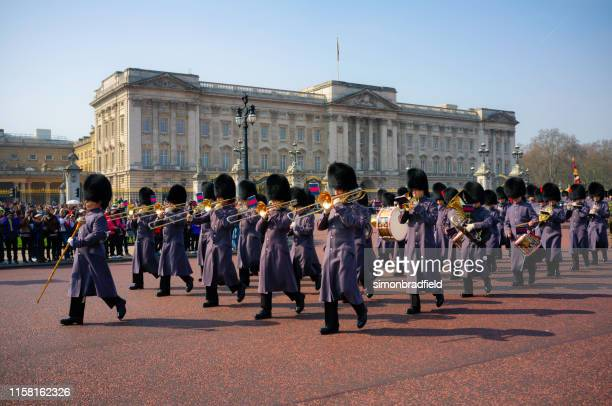 changing of the guard at buckingham palace - british royalty stock pictures, royalty-free photos & images