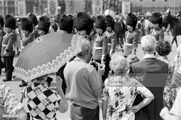 Changing of the Guard in London today An umbrella serves as a sunshade for a spectator 8th June 1976