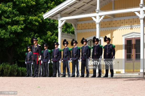 changing of the guard near royal palace in oslo, norway. - palace stock pictures, royalty-free photos & images