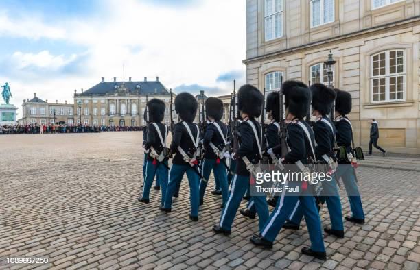 changing of the guard outside amalienborg palace in copenhagen, denmark - amalienborg palace stock pictures, royalty-free photos & images