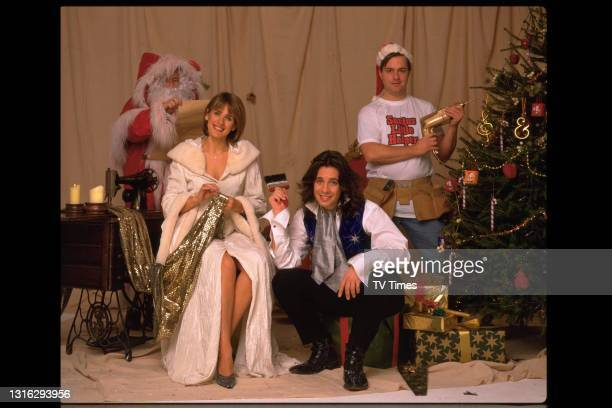 Changing Rooms presenters Carol Smillie, Andy Kane and Laurence Llewelyn-Bowen photographed on a Christmas-themed set, circa 1999.
