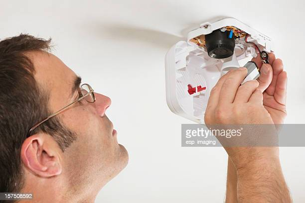 changing the battery in a fire alarm - sensor stock pictures, royalty-free photos & images