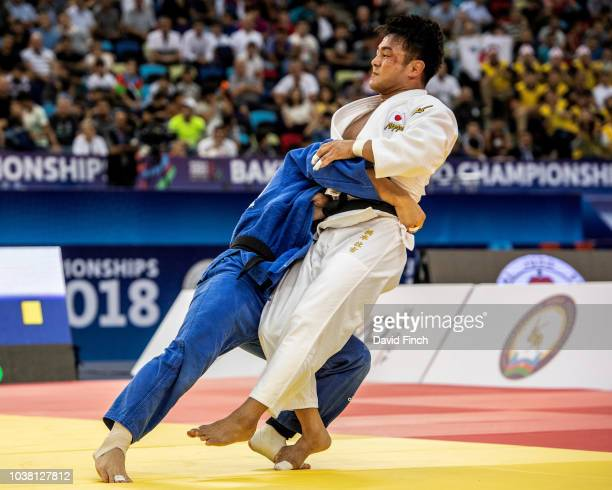 Changrim An of South Korea throws defending champion Soichi Hashimoto of Japan for an ippon to win the u73kg gold medal during day three of the 2018...