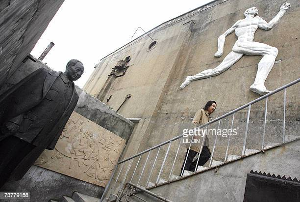 Chinese sculptor Lei Yixin , who is considered one of China's greatest sculptors, walks on the grounds of his studio where he is working on a new...