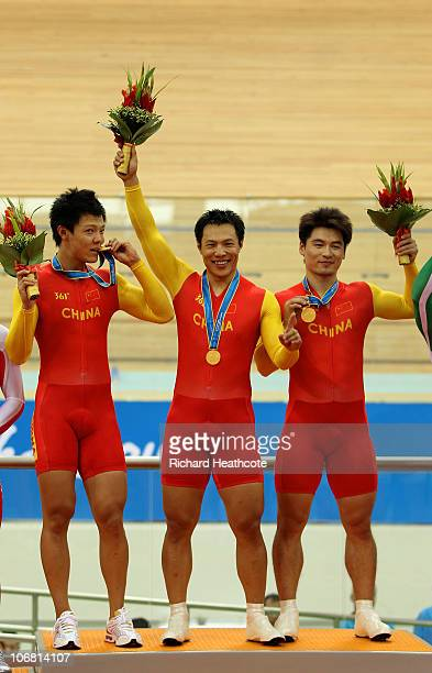 Changsong Cheng, Lei Zhang and Miao Zhang of team China win gold in the Men's Team Sprint Final at the Guangzhou Velodrome during day two of the 16th...