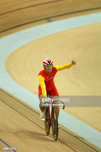 Changsong Cheng of China celebrates winning gold in the Men's Team Sprint Final at the Guangzhou Velodrome during day two of the 16th Asian Games...